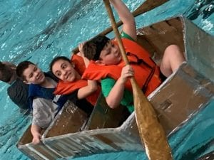 Students rowing boat.