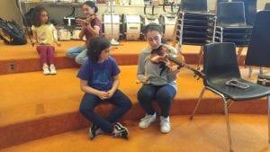 A student paractives her cello.